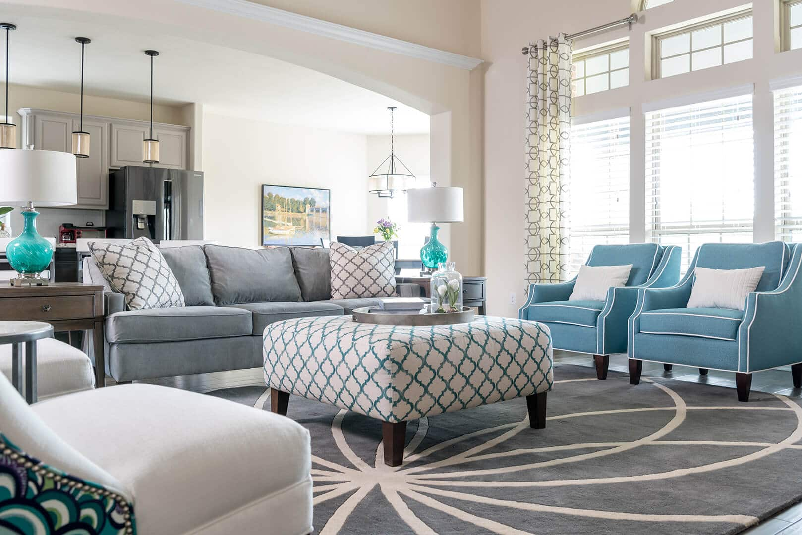 Blue & Gray Family Room Decorating Ideas with star patterned rug by Dee Frazier Interiors Decorating Den Interiors the best Dallas Interior Designer