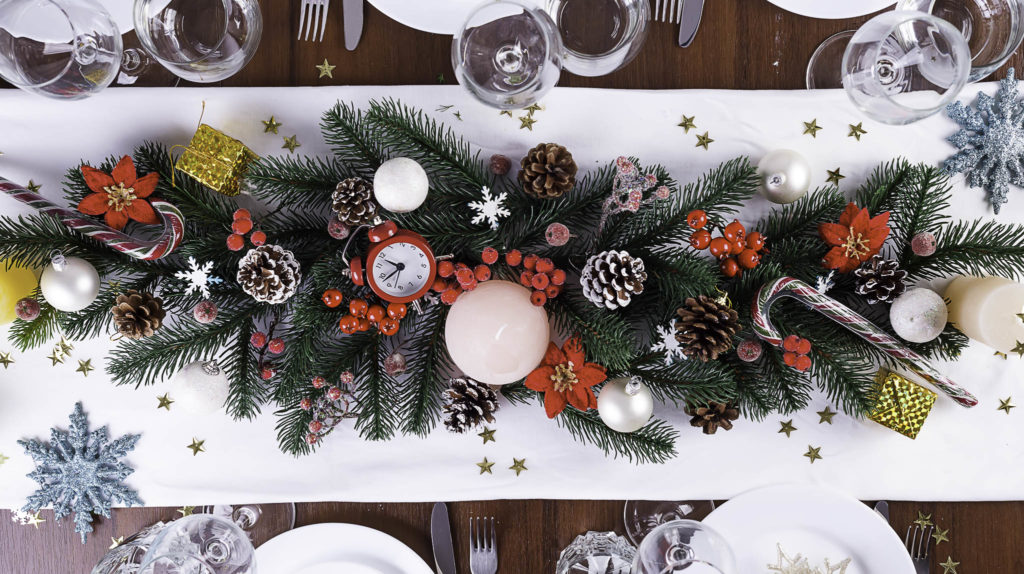 Christmas table setting with christmas decoration on dark wooden table, flat lay